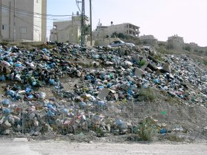 entrance & exit of rubbish lorries is controlled by Israel.
